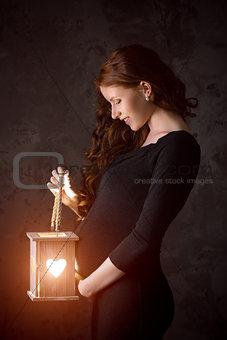 Beautiful pregnant woman enjoys new life