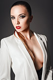 Studio fashion shot: beautiful young girl in white jacket