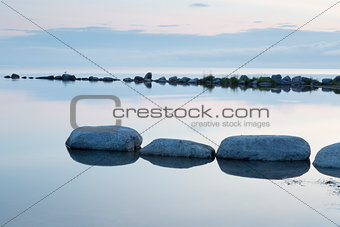 Breakwater Rocks in Calm Sea