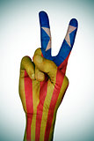 V sign patterned with the Catalan pro-independence flag