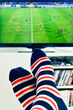 man watching a soccer match in the TV
