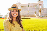 Smiling woman tourist in front of the Venice Square in Rome