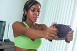 Black Athlete Woman Measures Body Fat With Electronic Equipment