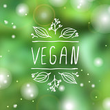 Vegan product label on blurred background