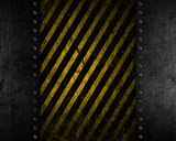Grunge metal background with yellow and black distressed texture