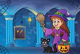 Cute witch and cat in haunted castle
