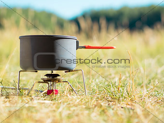 Can on portable camping stove