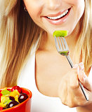 Pretty girl eating fruits