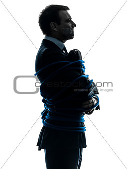 business man tied up prisoner silhouette