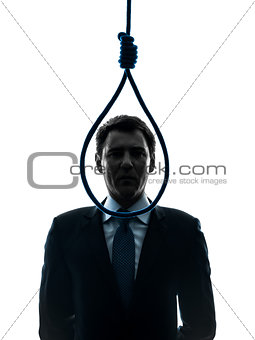 business man in front of  hangman noose silhouette