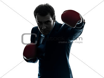 business man boxer with boxing gloves  silhouette