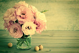 Gentle Flowers in a glass vase with copy space - retro toned