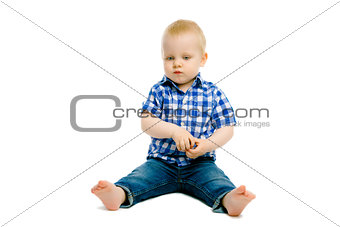 boy sitting on a white floor
