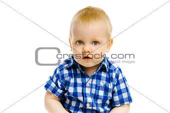 boy sitting on a white background