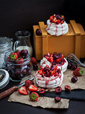 Pavlova meringue cake with fresh strawberry and cherry