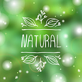 Natural product label on blurred background.