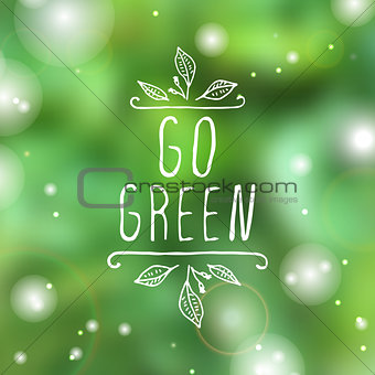 Go green - product label on blurred background.