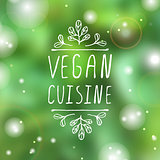 Vegan cuisine - product label on blurred background