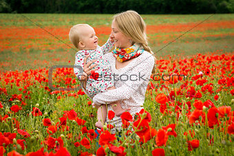 Mommy and daughter in a meadow