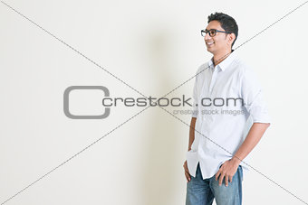 Casual business Indian male looking at side