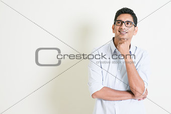Casual business Indian male thinking