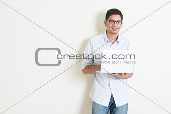 Casual business Indian male using laptop
