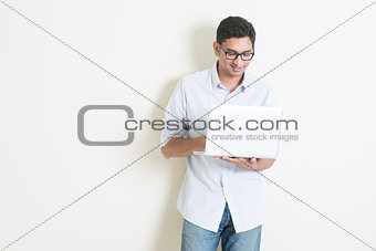 Casual business Indian man using laptop