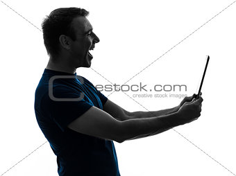 man holding digital tablet  laughing portrait  silhouette