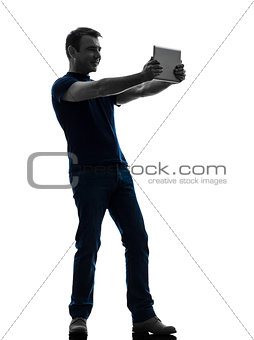 man holding watching  digital tablet  silhouette