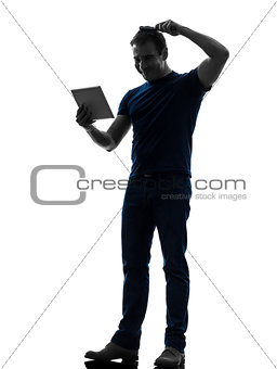 man holding digital tablet  brushing hair silhouette