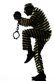 man prisoner criminal with chain ball silhouette escaping