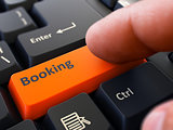 Press Button Booking on Black Keyboard.