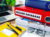 Resume Database on Red Ring Binder. Blurred, Toned Image.