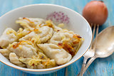 Dumplings with potatoes and fried onions.