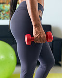 Home Fitness Black Woman Training Biceps With Weights-2