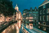 Night Amsterdam canal, church and bridge