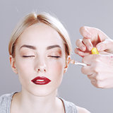 Professional Make-up artist applying makeup.