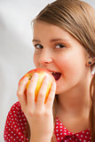 Teenage girl with apple