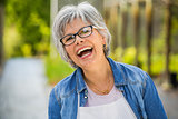 Mature woman laughing
