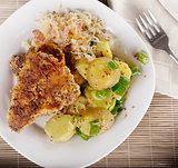 Schnitzel With Potato Salad and Sauerkraut