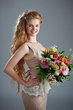 Pretty woman in dress with bouquet of flowers