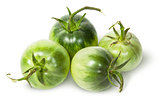 Four green tomatoes near