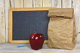 paper bag and red apple