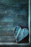 Blue wooden heart on wood