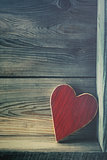 Wooden heart on shelf