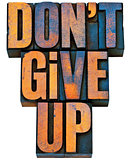 do not give up phrase in wood type