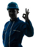 man construction worker okay gesture silhouette portrait
