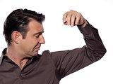 one caucasian man looking at sweat stain  sweating perspiring st
