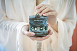Wedding day.Bride holding in the hands rings box.