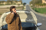 Angry man calling roadside assistance for his breakdown car